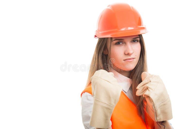 Venir femelle d'architecte ou de constructeur aux coups image libre de droits