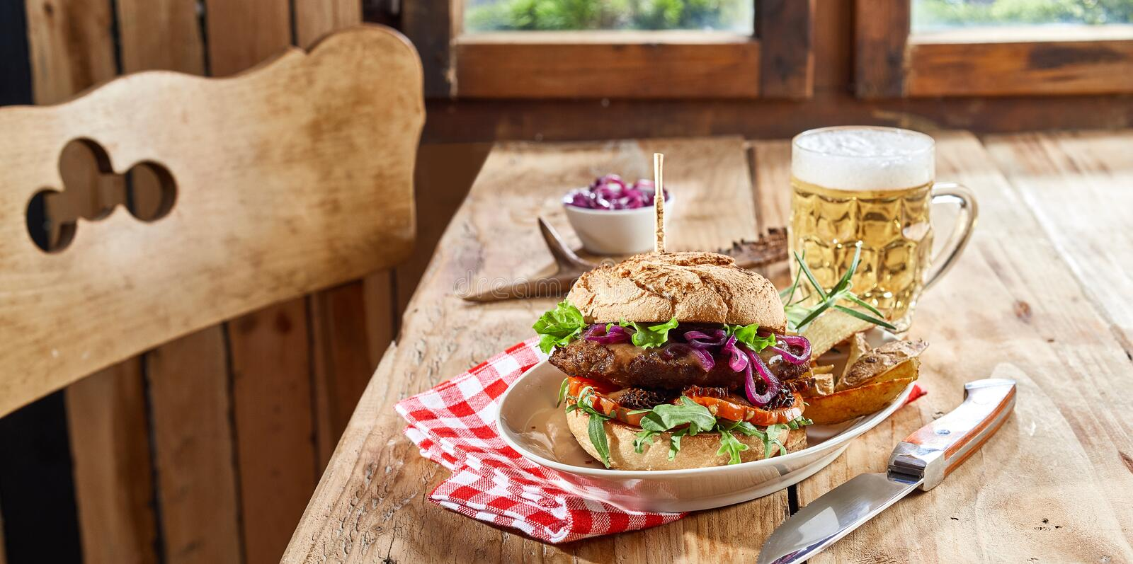 Venison burger with wild game patty royalty free stock image