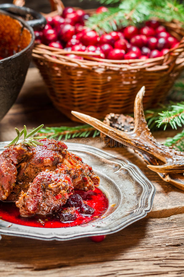 Venison with cranberry sauce in the forester royalty free stock image