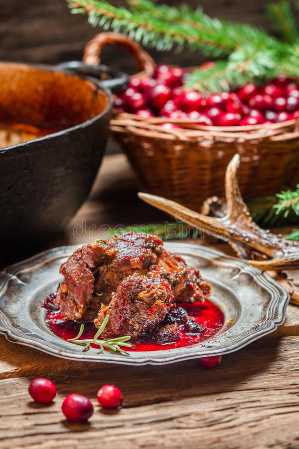 Venison with cranberry sauce and rosemary stock photo