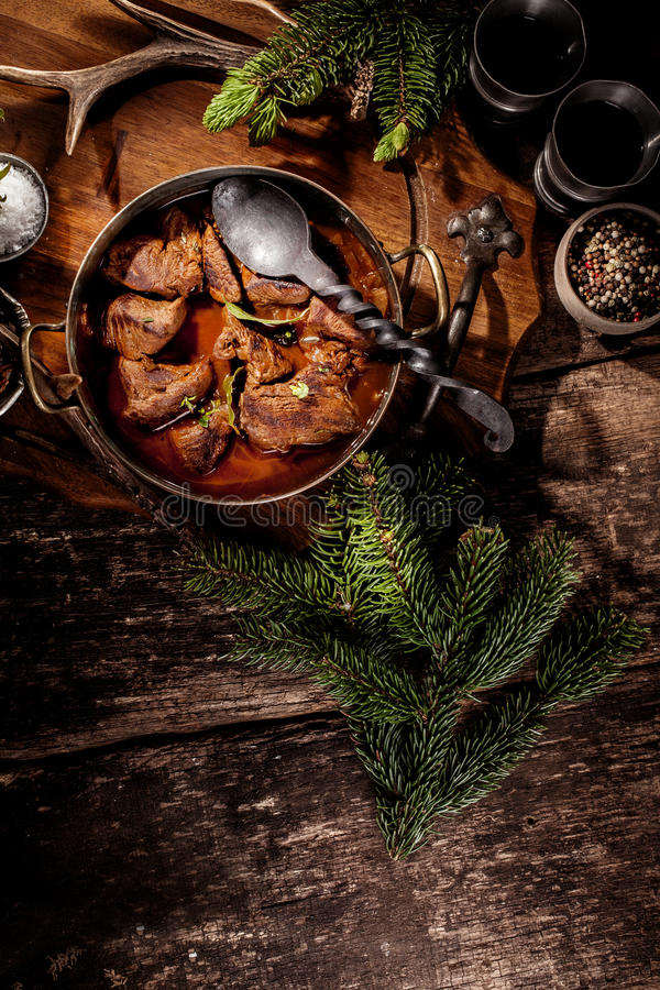 Venison Goulash Stew in Pot with Serving Spoon royalty free stock photo