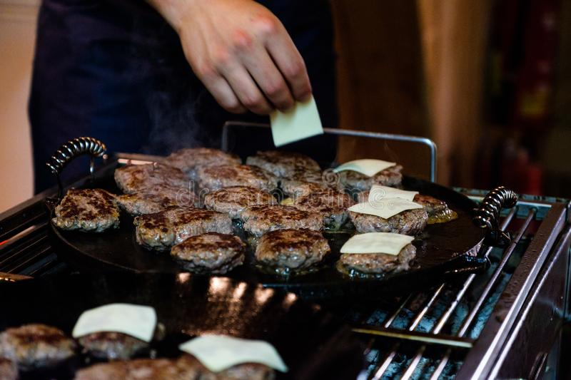 Venison Hamburgers fried on a barbecue grill stock photo