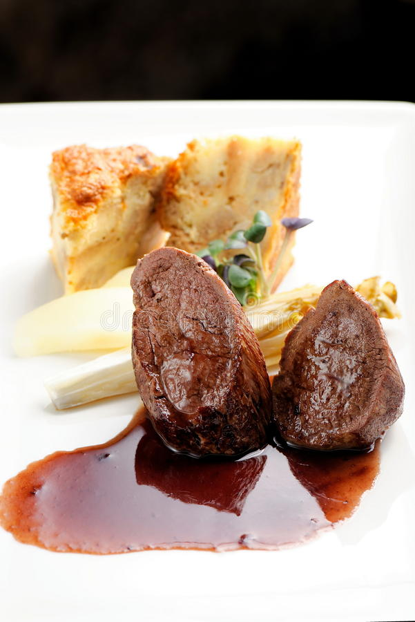Venison meat steak with Quiche pie royalty free stock image