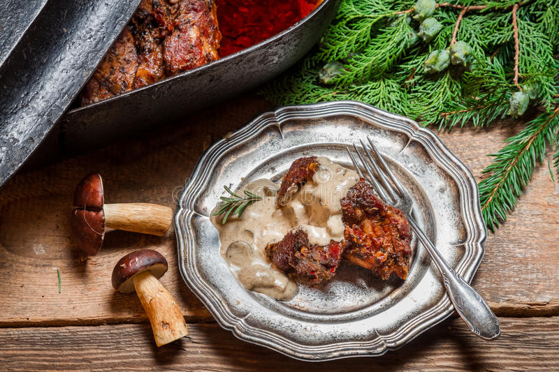 Venison served with wild mushroom sauce stock images