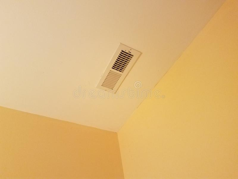 Vent on the ceiling. In a corner of a room royalty free stock photography