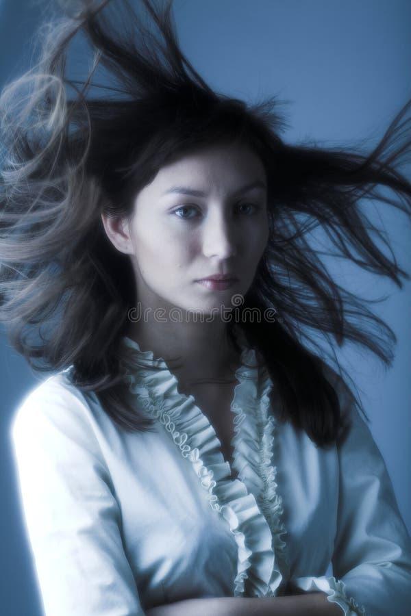 Vent dans les cheveux photos stock