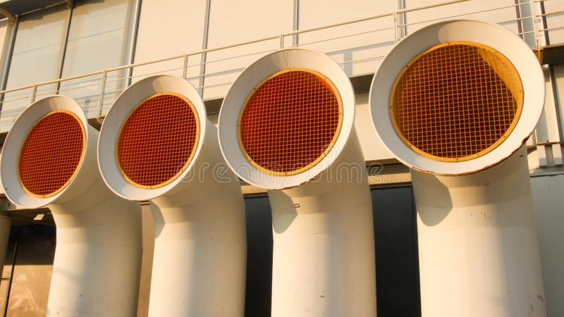 Vent pipes of a ship at the port of Genoa, towards evening royalty free stock photography