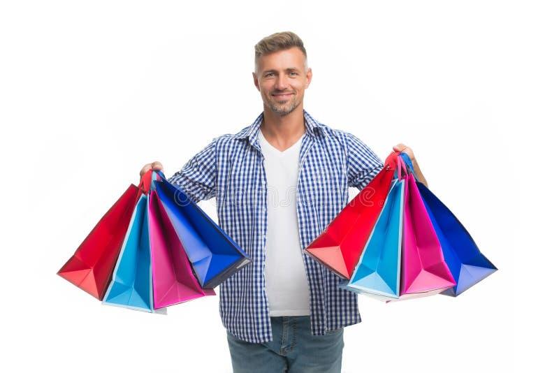 Venta total Hombre positivo que disfruta de hacer compras hombre feliz con los panieres aislados en blanco Individuo emocionado q imagen de archivo