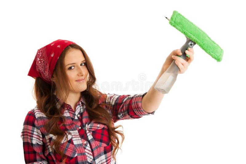 Ventanas felices de la limpieza de la mujer joven aisladas sobre el vackgroun blanco foto de archivo libre de regalías