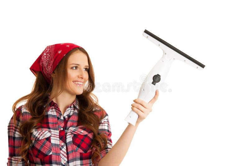 Ventanas felices de la limpieza de la mujer joven aisladas sobre el vackgroun blanco imagenes de archivo