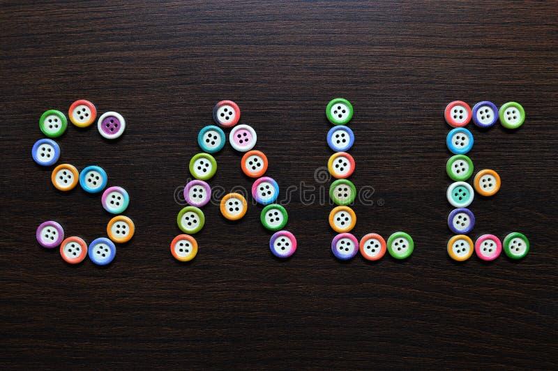 Vente écrite avec des boutons photographie stock libre de droits