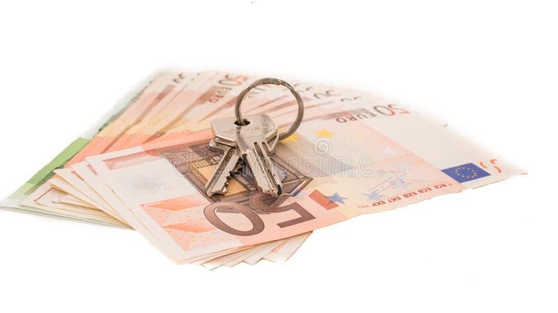 Vente d'immobiliers Argent achetant et vendant une maison image libre de droits