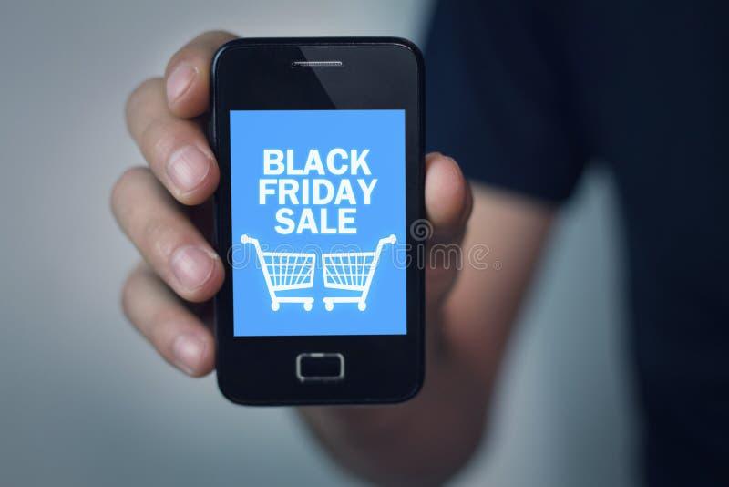 Vente de Black Friday au téléphone d'écran photographie stock