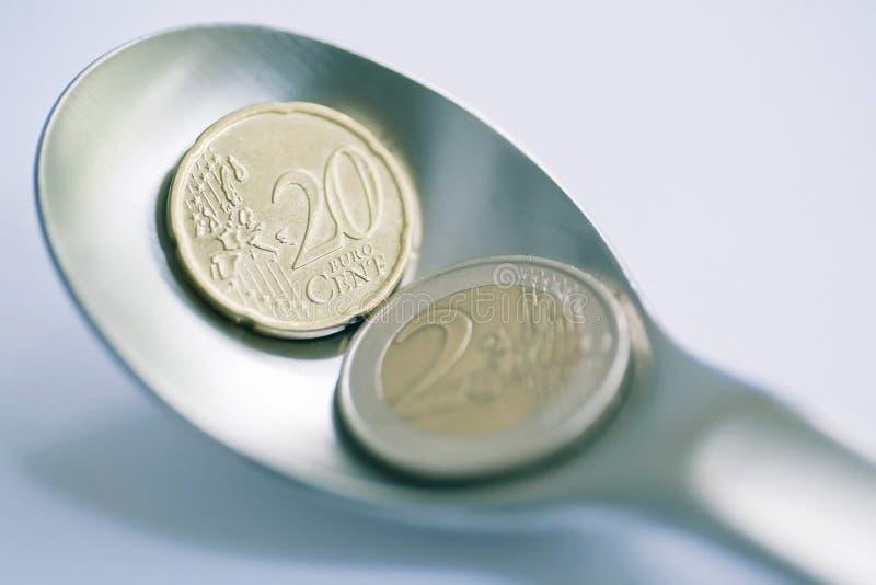 Venti centesimi e euro due come offerta immagine stock