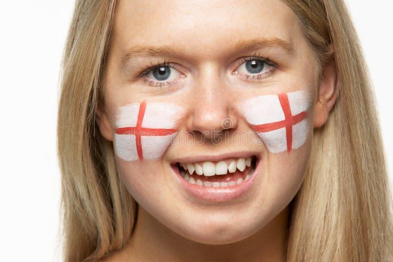 Ventilador de esportes fêmea com a bandeira do St Georges na face foto de stock royalty free