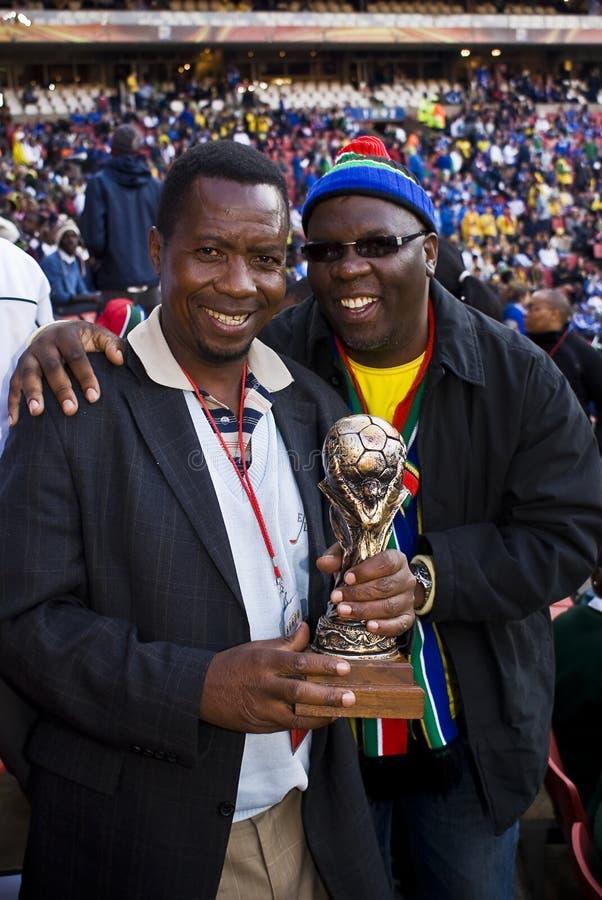 Ventilador de fútbol del SA liado hasta valiente el frío fotografía de archivo libre de regalías