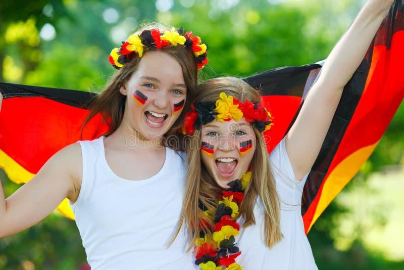 Ventiladores de fútbol alemanes al aire libre imagen de archivo libre de regalías