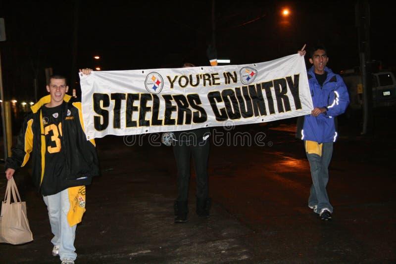 Ventiladores de Steelers que celebran la victoria fotografía de archivo