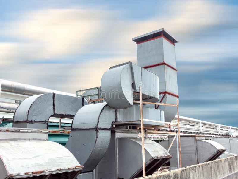 Ventilation Air Duct and HVAC System, Exhaust Hood for Air Blower in Manufacturing Food. Air Vent Blowing and Exhausting Machine. Equipment on Roofing Floor in stock images