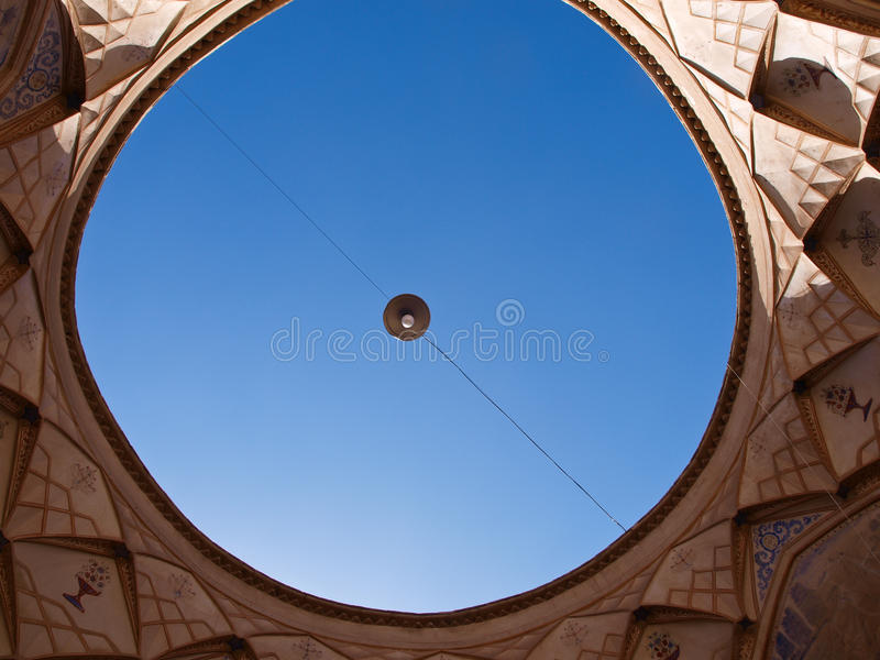 Ventilation hole and blue sky in kitchen in hist. Oric old house in Kashan in Iran stock photo