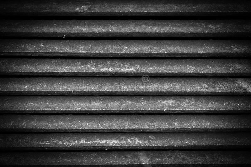 Ventilation metal grating. Vintage metal grid background. Black and white stock photo