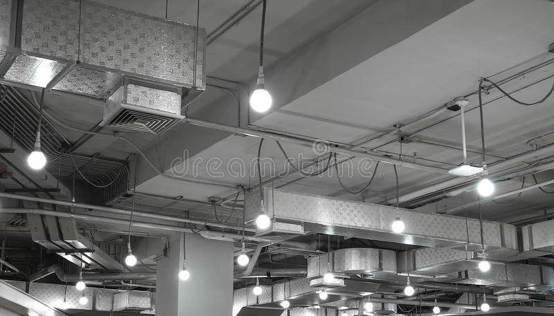 Ventilation system and light bulb in modern building. Steel ventilation system and light bulb in modern building stock photography