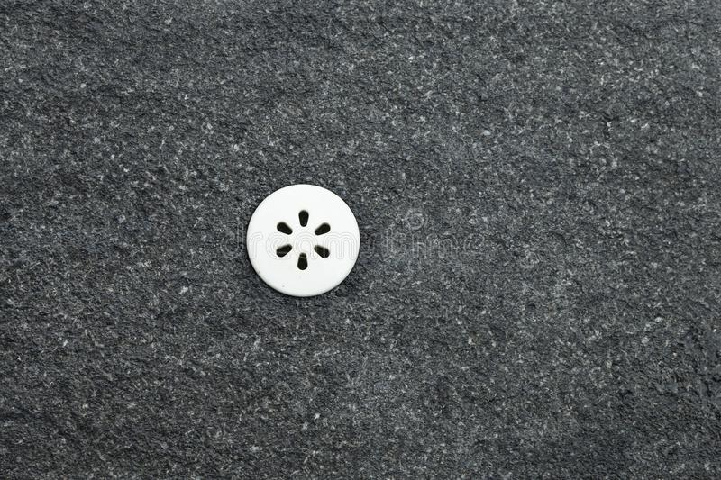 Ventilator for spraying water in a swimming pool mounted on black granite.  royalty free stock photos