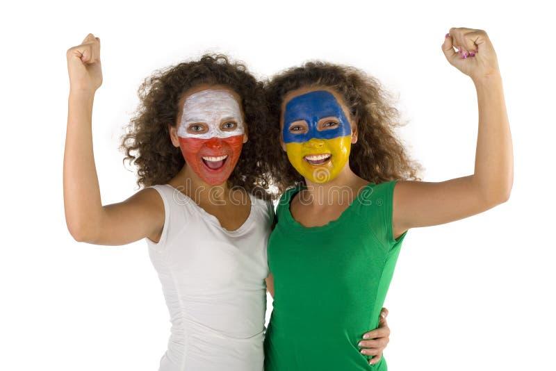 Ventilatori dello sport felici dei gemelli fotografia stock libera da diritti