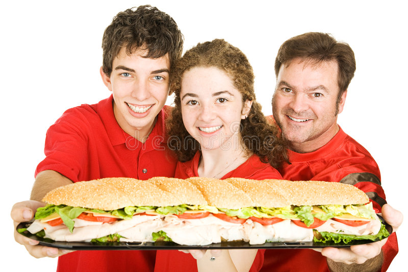 Ventilatori di sport con il panino gigante immagini stock