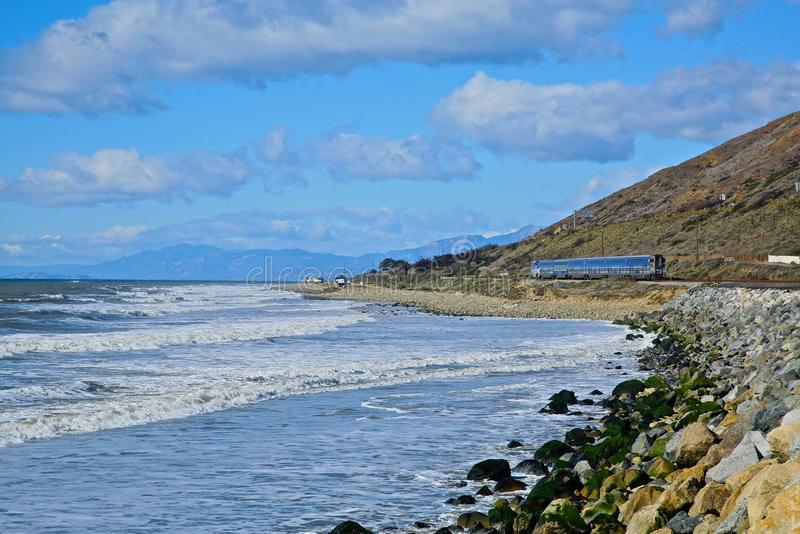 Ventura California train. Amtrak train chugs along the Ventura California coastline carrying passengers to their destinations stock images