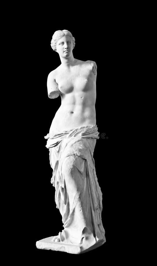 Venus de Milo on black background. The famous sculture Venus de Milo in the Louvre Museum, Paris, France on April 16, 2012. The sculture created sometime between royalty free stock image