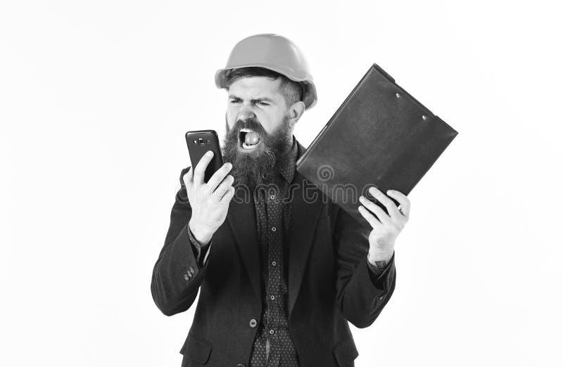Verärgerter Erbauer oder Erbauer, die an jemand schreien stockbilder
