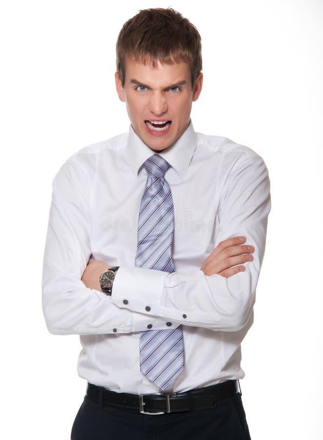 Verärgerter junger Geschäftsmann getrennt auf Weiß. lizenzfreies stockbild