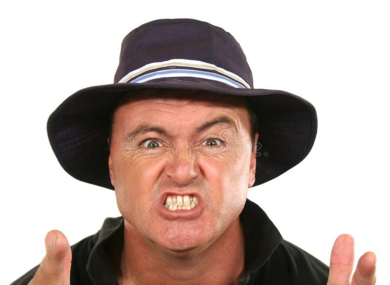 Verärgerter Mann im Hut lizenzfreies stockfoto