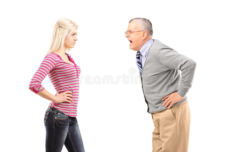 Verärgerter Vater, Der An Seiner Tochter Schreit Stockbilder