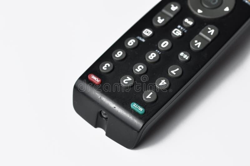 Ver controlemechanisme voor een TV die op een witte achtergrond wordt geïsoleerd De ruimte van het exemplaar stock afbeelding