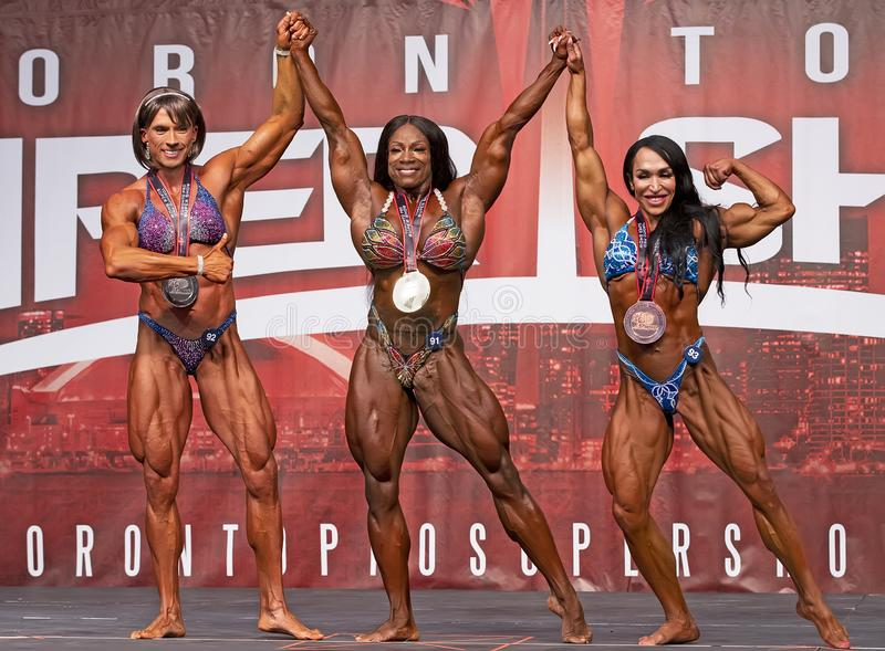 Women`s Bodybuilding Winners at 2019 Toronto Pro Supershow. Vera Mikulcova 2nd, Czech Republic, Margie Martin 1st Atlanta, Georgia, and Mona Poursaleh 3rd royalty free stock image