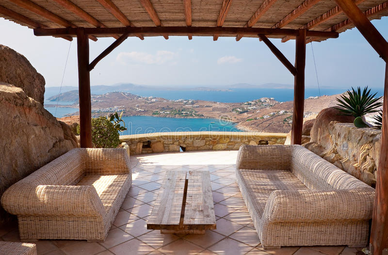 Veranda with wicker furniture in a hotel. Overlooking the sea and islands royalty free stock image