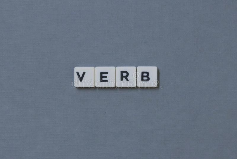 ' Verb ' word made of square letter word on grey background stock photography