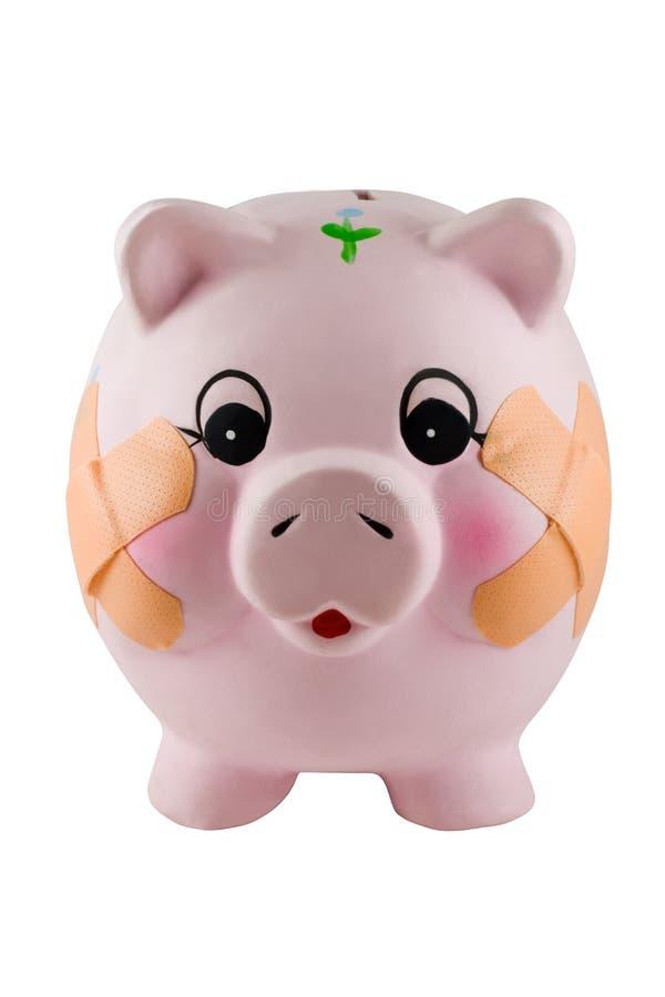 Verband auf Piggy Querneigung lizenzfreies stockbild