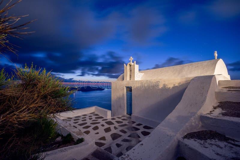 Verbazende avondmening van Fira, caldera, vulkaan van Santorini, Griekenland royalty-vrije stock foto's