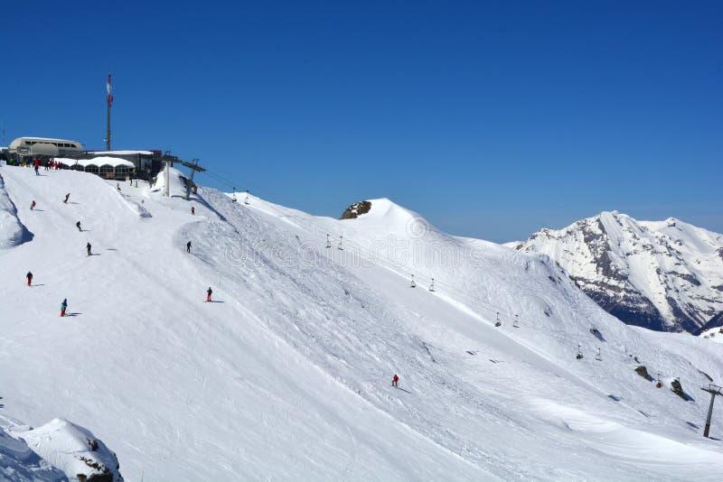 Verbier Skiing. Skiing at the swiss luxury resort of Verbier in Southern Switzerland. The Attelas ski lift stock image