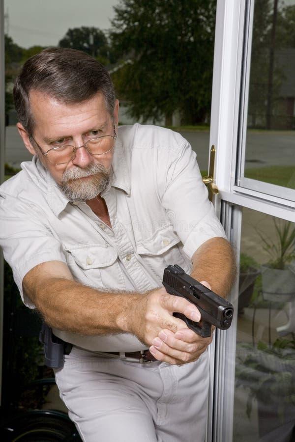 Verbrecher im Haus lizenzfreie stockfotos