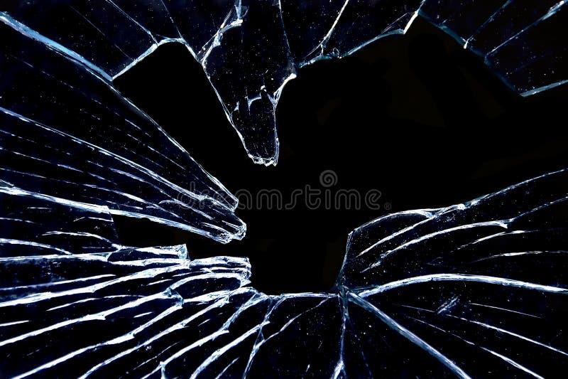 Verbrijzeld glas op straalzwarte stock foto