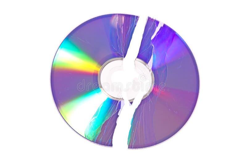 Verbrijzelde DVD/CD die op wit wordt geïsoleerda royalty-vrije stock foto's
