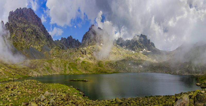 Vercenik mountain and crater lake clouded with foggy skies. In Rize - Turkey stock image