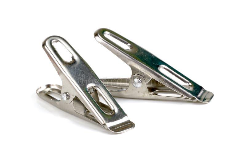 Verdübeln Sie Stahl, die Metallwäscheklammer, die auf weißem Hintergrund lokalisiert wird lizenzfreies stockbild