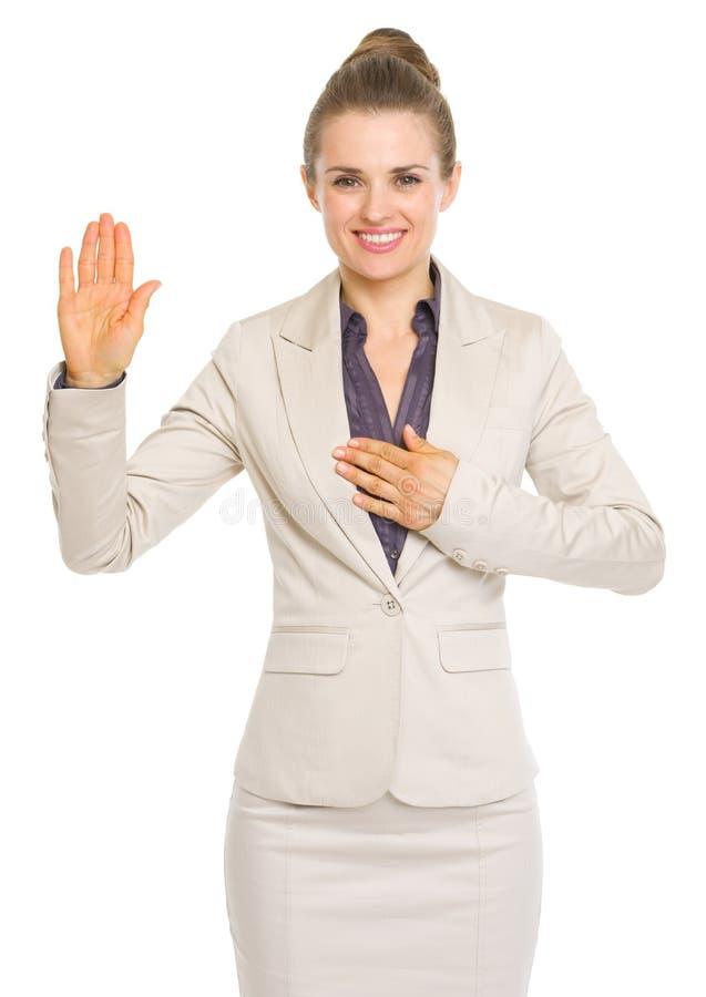Verdade do juramento da mulher de negócio imagem de stock royalty free