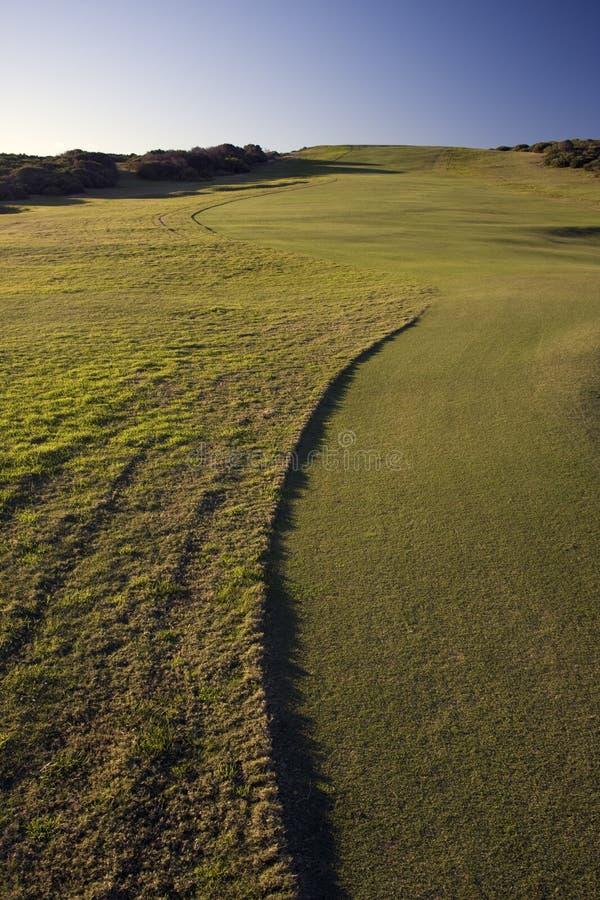 Verde del campo de golf en parque nacional de la bahía de la botánica imagenes de archivo