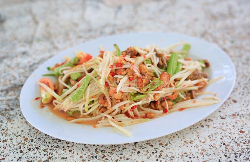 ` Verde del SOM TAM del ` de la ensalada de la papaya Comida popular deliciosa de Tailandia foto de archivo libre de regalías
